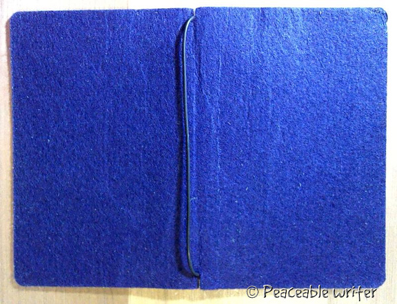 Stiff felt cut to size of pocket Moleskine