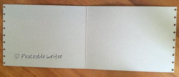 Envelope split open, and put through Levenger Circa punch